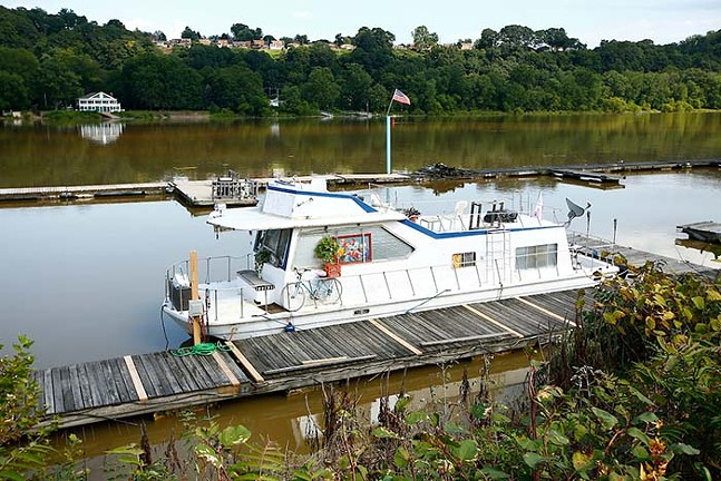 A houseboat owned by Mia Macdonald sits along the Allegheny River at the Bell Harbor Yacht Club. - CP PHOTO: JARED WICKERHAM