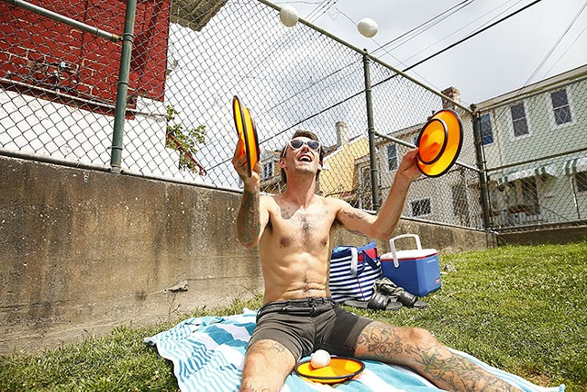 Juggler O'Ryan the O'mazing! practices while his son swims at the Bloomfield pool on its last open day this summer on Thu., Aug. 15. - CP PHOTO: JARED WICKERHAM