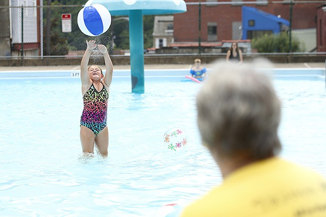 Olivia Orlando, 8, hits a beach ball back to her grandmother, Denise Finley, at the Bloomfield pool - CP PHOTO: JARED WICKERHAM