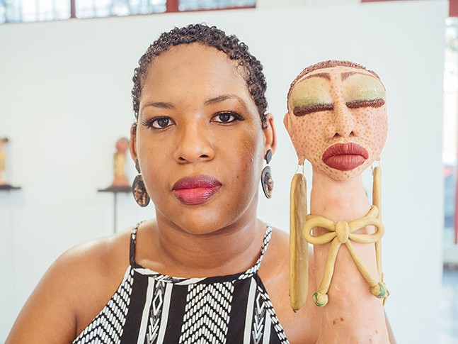 Dominique Scaife with her artwork - CP PHOTO: JARED MURPHY