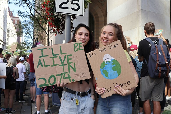 "Billie Salvucci, 16, and Scarlott Burns, 16, skipped school to participate in the Climate Strike. ""I go to a lot of protests, but to me this is the most important one because nothing else will really matter if the world dies. I think this is my top priority at the moment,"" Salvucci said. - CP PHOTO: JOIE KNOUSE"