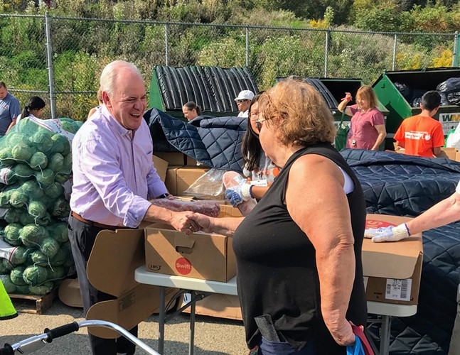Mike Doyle (left) at the Greater Pittsburgh Community Food Bank's Produce to People program - PHOTO COURTESY OF THE OFFICE OF MIKE DOYLE