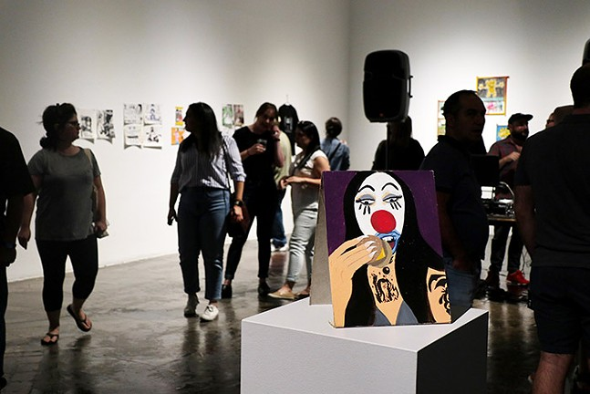 Visitors check out SPACE Gallery's Mutant Media exhibit. - CP PHOTO: JOIE KNOUSE