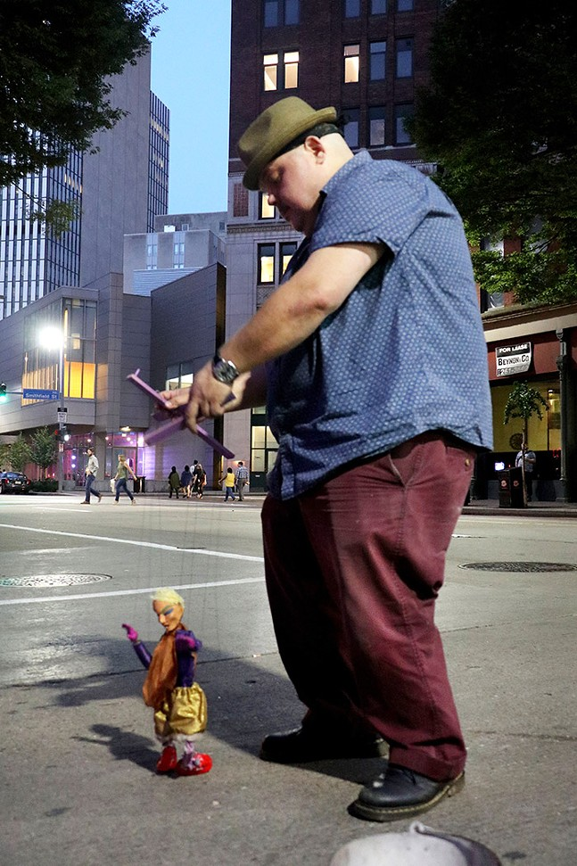 Puppeteer Dave English performs along Liberty Avenue. - CP PHOTO: JOIE KNOUSE