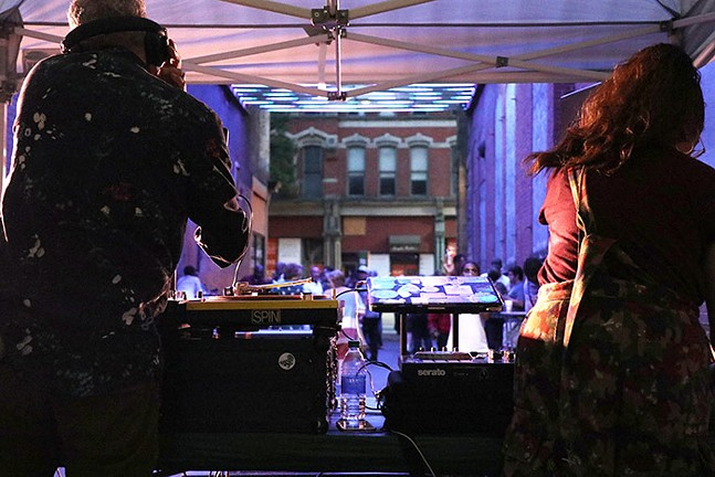 DJs perform in Garrison Place, an alley illuminated with a light display by artist Andrea Polli - CP PHOTO: JOIE KNOUSE