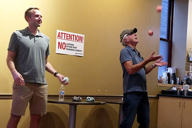 Zeeppo the Clown teaches people to juggle during a clown class inside Crazy Mocha. - CP PHOTO: JOIE KNOUSE