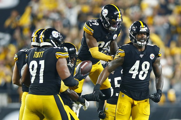 Bud Dupree is congratulated by teammates following a strip sack. - CP PHOTO: JARED WICKERHAM