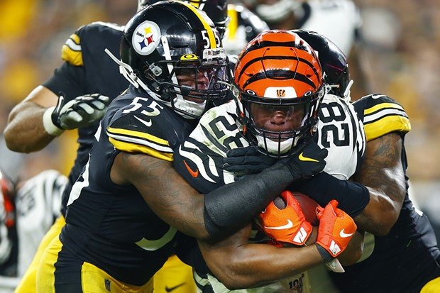 Joe Mixon #28 of the Cincinnati Bengals is tackled by Devin Bush #55 of the Steelers. - CP PHOTO: JARED WICKERHAM