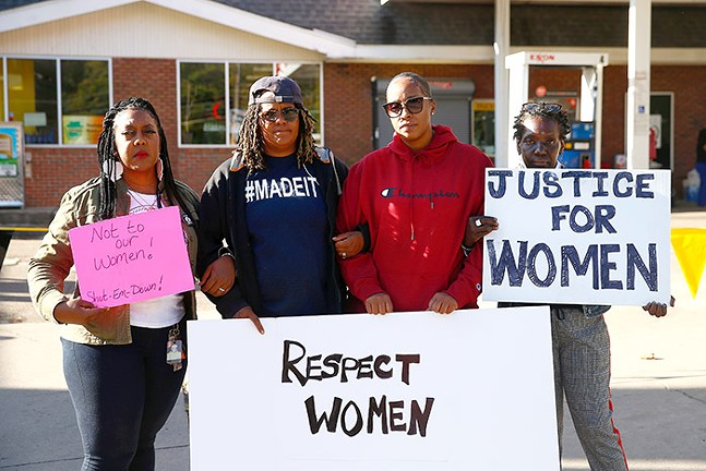 Amber Sloan (second from left) protesting outside the Exxon gas station in Marshall-Shadeland - CP PHOTO: JARED WICKERHAM