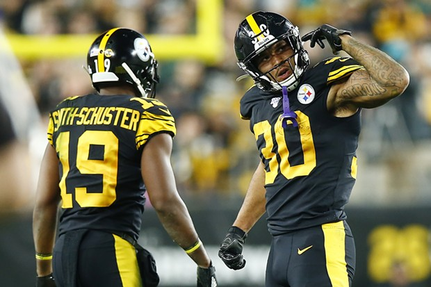 James Conner #30 of the Pittsburgh Steelers reacts after running with the ball. - CP PHOTO: JARED WICKERHAM