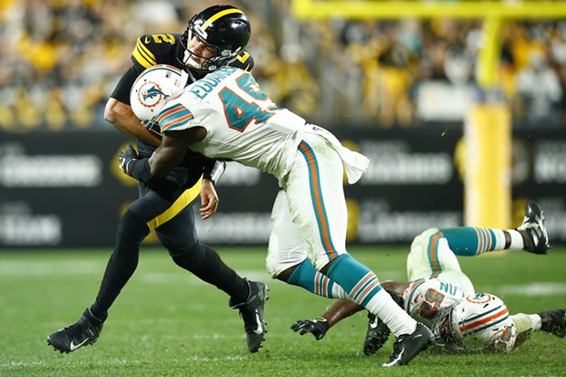 Mason Rudolph #2 of the Pittsburgh Steelers is hit Sam Eguavoen #49 of the Miami Dolphins. - CP PHOTO: JARED WICKERHAM