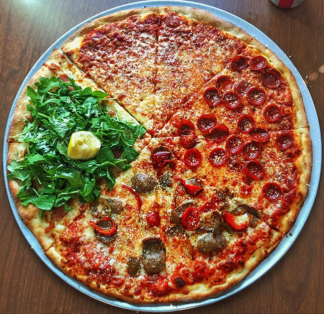 A mixed pie from Rockaway Pizzeria: (clockwise from top) plain, pepperoni, hot sausage and peppers, prosciutto and arugula - PHOTO: DAN TALLARICO