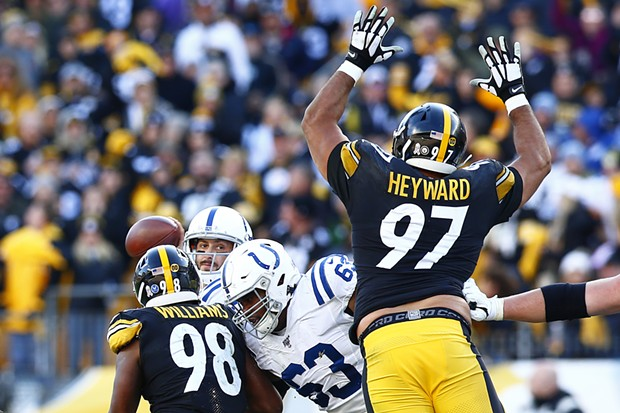 Cameron Heyward #97 of the Pittsburgh Steelers jumps in front of a throwing Brian Hoyer. - CP PHOTO: JARED WICKERHAM