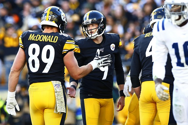 Chris Boswell #9 of the Pittsburgh Steelers is congratulated by teammate Vance McDonald following a field goal. - CP PHOTO: JARED WICKERHAM