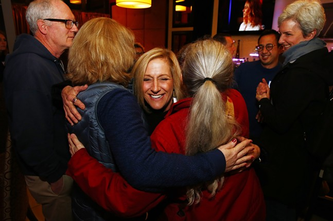 Lisa Middleman is greeted by supporters at her election party inside the Savoy restaurant. - CP PHOTO: JARED WICKERHAM