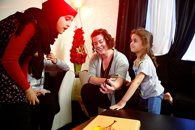 Maha and Masa Knaineh with Hello Neighbor mentor Clare Wardwell - CP PHOTO: JARED WICKERHAM