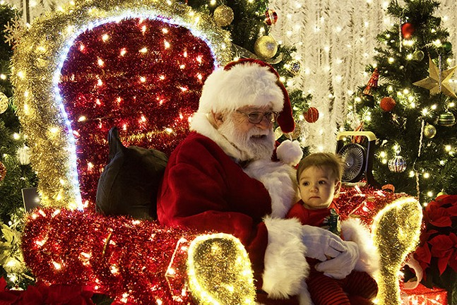 Santa takes holiday photos with children. - CP PHOTO: JOIE KNOUSE