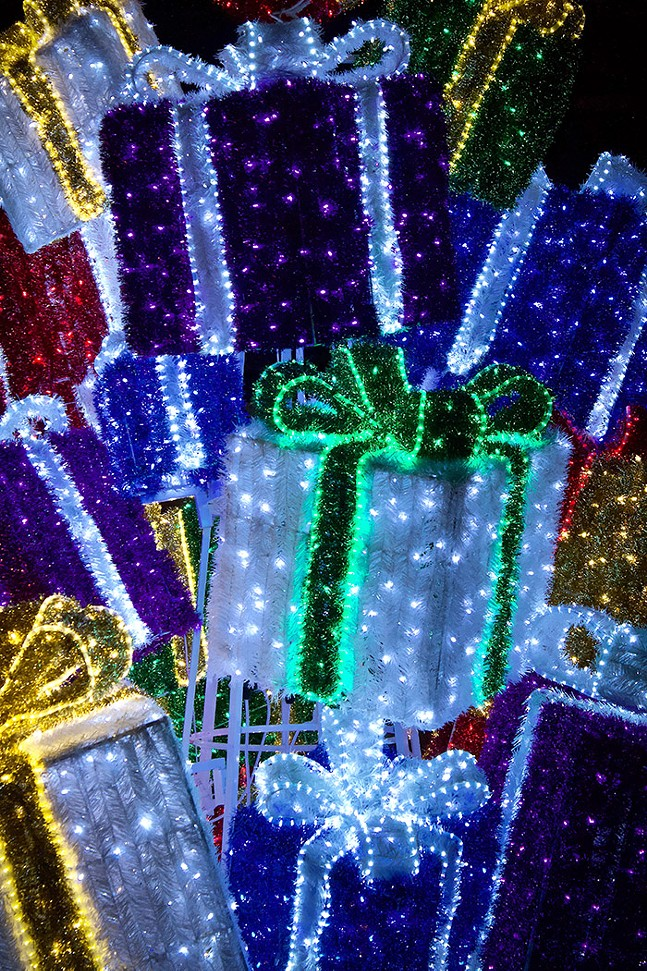 A tree shaped out of brightly lit presents - CP PHOTO: JOIE KNOUSE