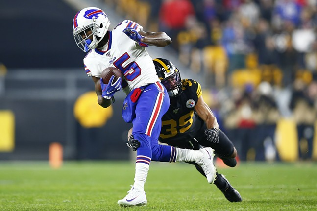 Minkah Fitzpatrick #39 of the Pittsburgh Steelers tackles John Brown #15 of the Buffalo Bills. - CP PHOTO: JARED WICKERHAM