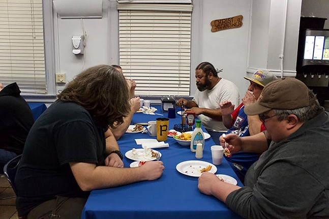 Clients at the Light of Life Rescue Mission eat lunch served by volunteers and staff members - CP PHOTO: JOIE KNOUSE