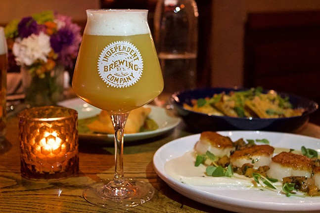 Craft beer on tap along with dayboat scallops (front) and sweet potato ravioli (back) at Independent Brewing Company - CP PHOTO: JOIE KNOUSE