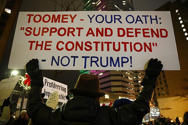 Hundreds rally in Downtown Pittsburgh in support of the impeachment of President Trump - CP PHOTO: JARED WICKERHAM