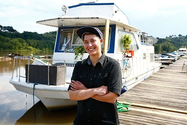 Mia Macdonald and her houseboat - CP PHOTO: JARED WICKERHAM