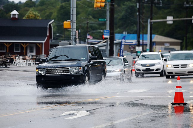 Vehicles during flooding on Route 51 in the South Hills - CP PHOTO: JARED WICKERHAM