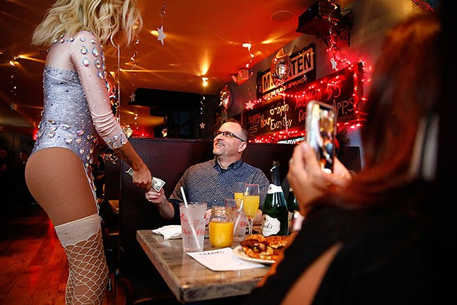 Patrons hand out tips to performers during a drag brunch at Frank's Bar and Grill. - CP PHOTO: JARED WICKERHAM