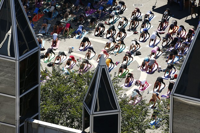 Yoga takes place in Market Square during Open Streets in downtown. - CP PHOTO: JARED WICKERHAM