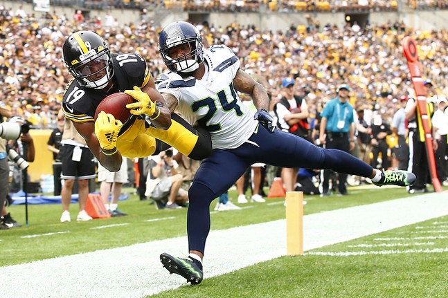 JuJu Smith-Schuster #19 of the Pittsburgh Steelers catches a pass before being pushed out of bounds for a ruled incompletion in front of Jamar Taylor #24 of the Seattle Seahawks. - CP PHOTO: JARED WICKERHAM