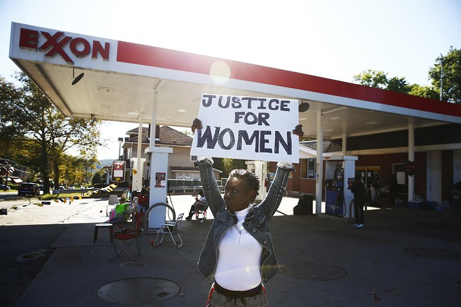 Vanetta Olds protests at the Exxon Mobile gas station near Marshall-Shadeland. - CP PHOTO: JARED WICKERHAM