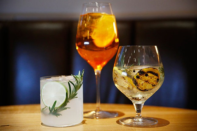 A house gin and tonic, Aperol spritz, and Rosemary Gilmet from Alta Via - CP PHOTO: JARED WICKERHAM