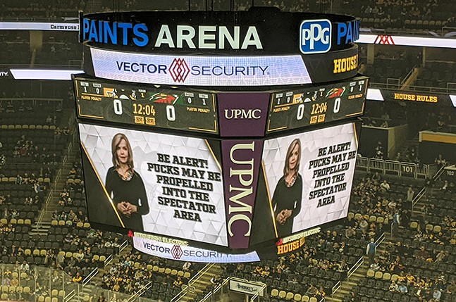 Pittsburgh media personality Sally Wiggin reads the arena rules before the start of the game. - CP PHOTO: LISA CUNNINGHAM