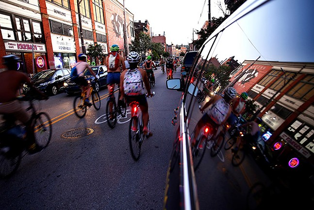 Cyclists on Butler Street in Lawrenceville - CP PHOTO: JARED WICKERHAM
