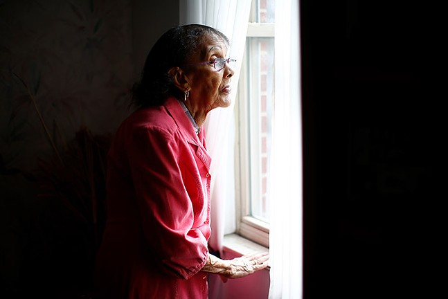 Edna Council poses for a portrait inside of her home in the Hill District. - CP PHOTO: JARED WICKERHAM