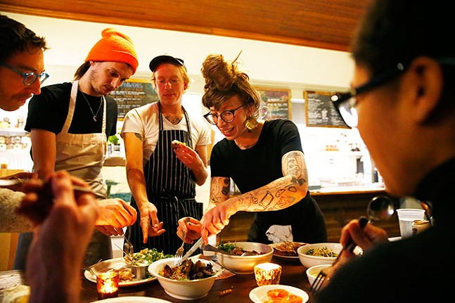 Co-owners of the Fet-Fisk pop-up dinners, Sarah LaPonte and Nik Forsberg, taste test food with their staff prior to the start of their pop-up dinner at Pear and the Pickle in Troy Hill. - CP PHOTO: JARED WICKERHAM