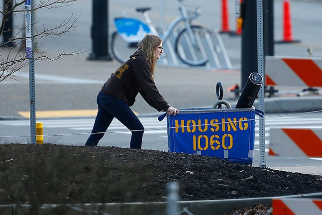 A student pushes a housing cart with her belongings on the University of Pittsburgh campus in Oakland on Sun., March 15. - CP PHOTO: JARED WICKERHAM