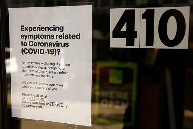 A sign hangs on the door of H&R Block on Smithfield Street in Downtown Pittsburgh on Sun., March 15. - CP PHOTO: JARED WICKERHAM