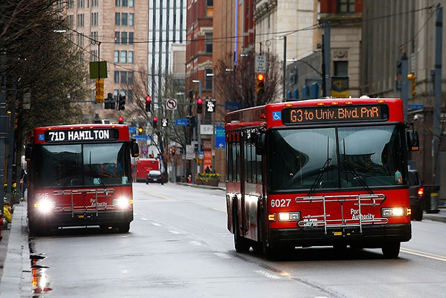 Port Authority buses drive through Downtown Pittsburgh on Mon., March 23. - CP PHOTO: JARED WICKERHAM