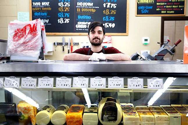 Anthony Guido, cashier at Bryant Street Market in Highland Park - CP PHOTO: JARED WICKERHAM