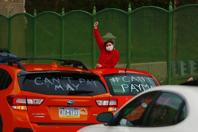 A #CantPayMay drive-by protest in Pittsburgh on Fri., May 1 - CP PHOTO: JARED WICKERHAM
