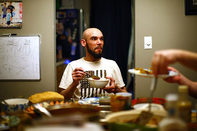 Mohcine Eljoufri, director of the Islamic Center of Pittsburgh, breaks fast with his family at their home during Ramadan on Sun., May 3, 2020. - CP PHOTO: JARED WICKERHAM