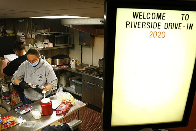 Riverside Drive In co-owner Emma Ross puts together to-go orders at the theater's concession stand on Sat., May 9, 2020 in Vandergrift, Pa. - CP PHOTO: JARED WICKERHAM