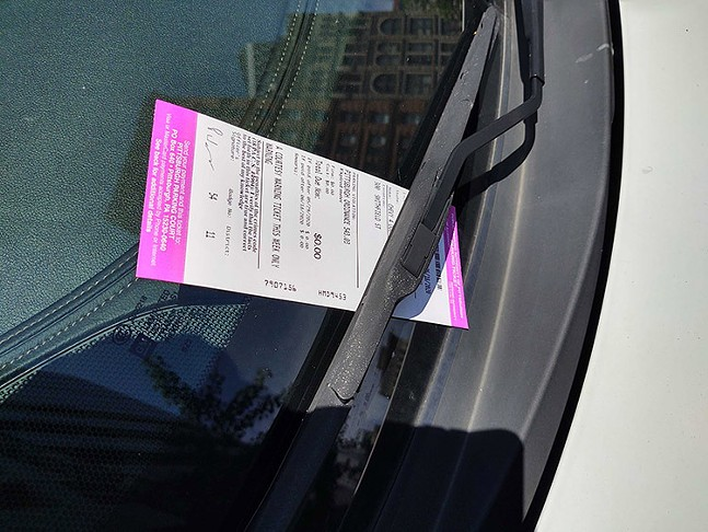 A courtesy parking ticket left on a car window on Smithfield Street in Downtown Pittsburgh on Mon., May 18, 2020. - CP PHOTO: KEVIN SHEPHERD