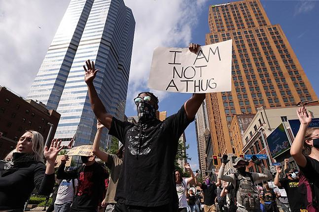 Marchers in Downtown Pittsburgh - CP PHOTO: SEBASTIAN FOLTZ