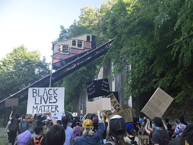 Pittsburghers march under the Monongahela Incline on Sun., June 7, 2020. - CP PHOTO: RYAN DETO