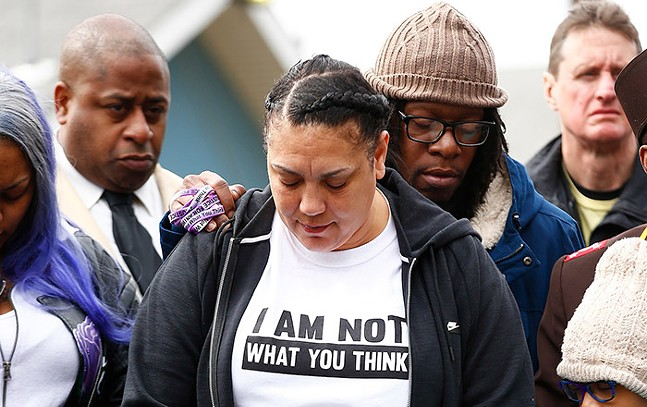 Michelle Kenney joined community members inside Hawkins Village for a vigil in honor of Antwon Rose II on Sun., March 24, 2019. - CP PHOTO: JARED WICKERHAM