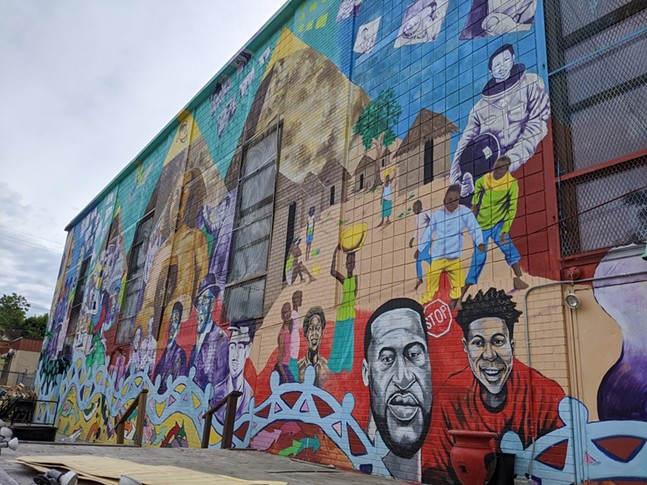 Black history mural on the Community Empowerment Association building in Homewood - CP PHOTO: AMANDA WALTZ