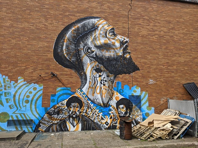 Nipsey Hussle with John Huggins and Bunchy Carter, part of the Black history mural in Homewood. - CP PHOTO: AMANDA WALTZ